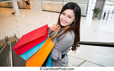 beautiful young woman shopping in mall
