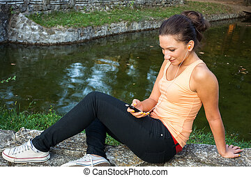 young woman with smart phone - Young woman using smartphone...
