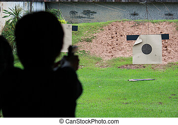 Shooting gun at field for practice