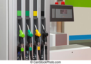Filling station - Color coded fuel nozzles at petrol station