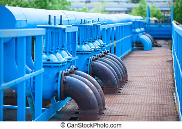 Many blue gas pipelines with stop-gate valves at industrial...