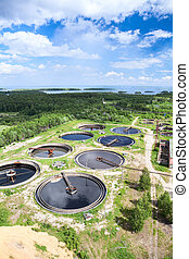 Sewage treatment plant with huge circular volumes for...