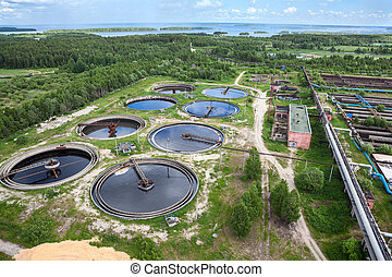 Industrial wastewater treatment circular settlers, aerial...