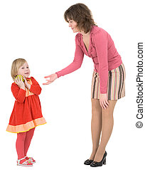 Woman asks apple beside little girl - Woman asks green apple...
