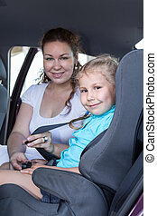Safety children transportation with car seat in vehicle...