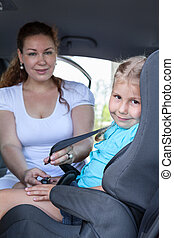 Children trasportation with baby car seat. Cacasian family...