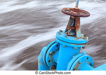 Close-up view of gate valve with blue pipeline for oxygen...