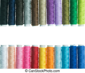 Bobbins of thread isolated on white background