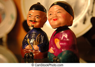 Chinese figurines - The close up of Chinese old couple...