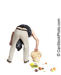 Man with back pain dropped fruit basket