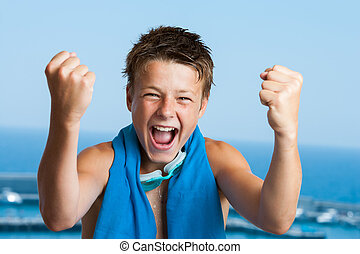 Victorious teen swimmer. - Portrait of teen swimmer with...