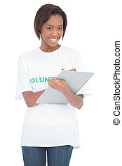 Smiling volunteer woman holding clip board on white...