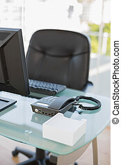 Empty classy bright office with sunny background through...
