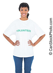 Content black haired volunteer posing with hands on the hips...