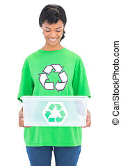 Delighted black haired ecologist holding a recycling box on...
