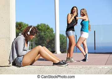 Two teen girls bullying another one - Two teen girls...