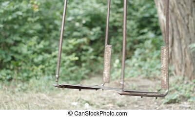 an old swing - lonely seesaw close-up