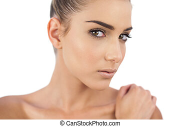 Close up of a thoughtful woman looking at camera