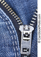 jeans zipper - macro image of an open jeans zipper