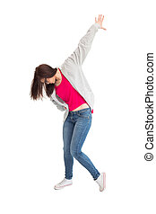 Trendy young woman dancing on white background