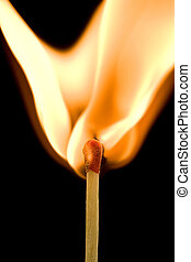 Igniting match - Macro of an ignited matchstick flame in the...