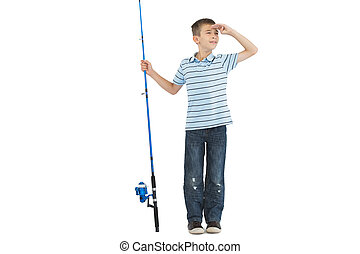 Young boy holding fishing rod looking away - Young boy...