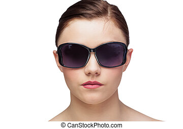 Young model wearing classy sunglasses on white background
