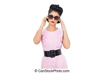 Concentrated black hair model wearing sunglasses on white...