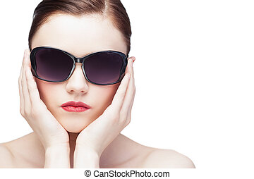 Glamorous young model wearing stylish sunglasses on white...