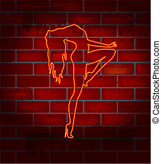 Striptease dancing girl - Neon image on a brick wall dancing...