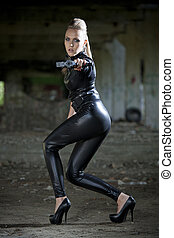 sexy gun woman in leather suit