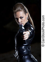 woman with gun in leather