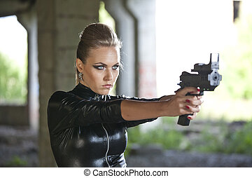 woman with gun in leather suit
