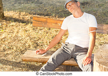 Heroin addict experiencing a state of relaxation and...