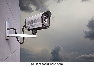CCTV Camera with clouds - CCTV Camera attached to wall with...