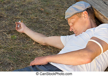 Heroin user experiencing unconsciousness after drug dose...