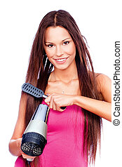 woman holding blow dryer and comb - woman with long hair...