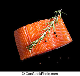 Raw salmon. - Raw salmon steak isolated on black background...