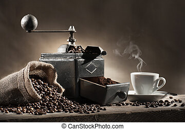 coffee grinder - coffee beans in jute bag with coffee...