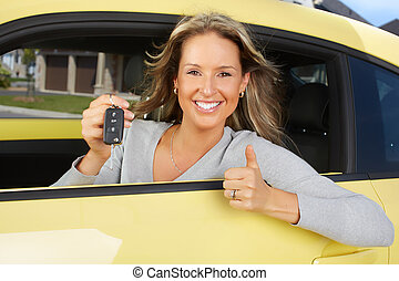Woman car driver - Young beautiful woman car driver in a new...