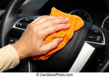 Hand cleaning car - Hand with microfiber cloth cleaning car...