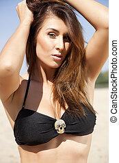 Portrait of beautiful brunette woman in black bikini