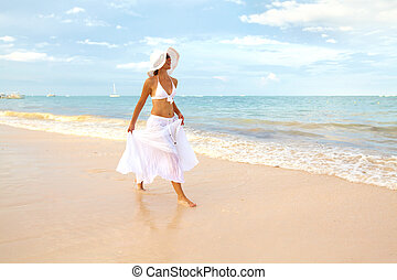 Happy woman on Punta Cana beach.