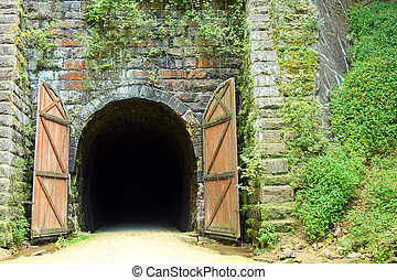 Old Rail Bike Tunnel - An old stone tunnel entrance on a...