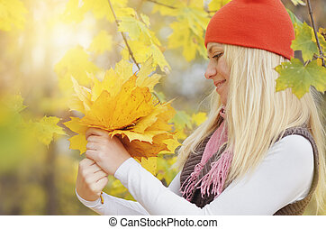 Girl with a bouquet of leaves