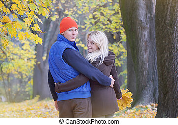Loving couple in the autumn park - Young loving couple...