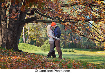 Happy couple under the tree - Happy couple resting in autumn...