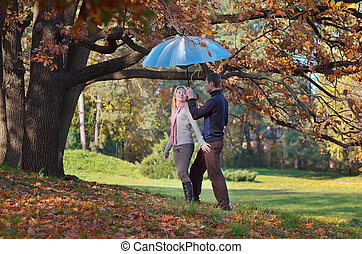Happy couple with umbrella - Couple in love with blue...