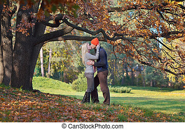 Couple kisses - Happy couple kissing in autumn forest