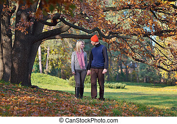Couple in the park - Happy couple resting in autumn park...